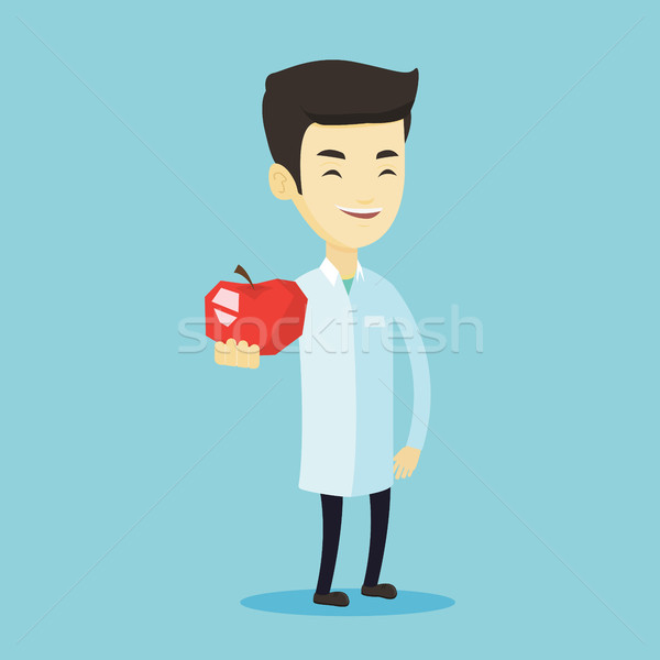 Nutritionist offering fresh red apple. Stock photo © RAStudio