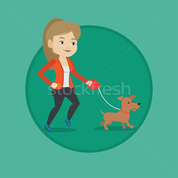 Young woman walking with her dog. Stock photo © RAStudio