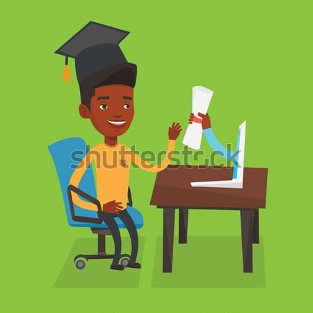 Graduate getting diploma from the computer. Stock photo © RAStudio