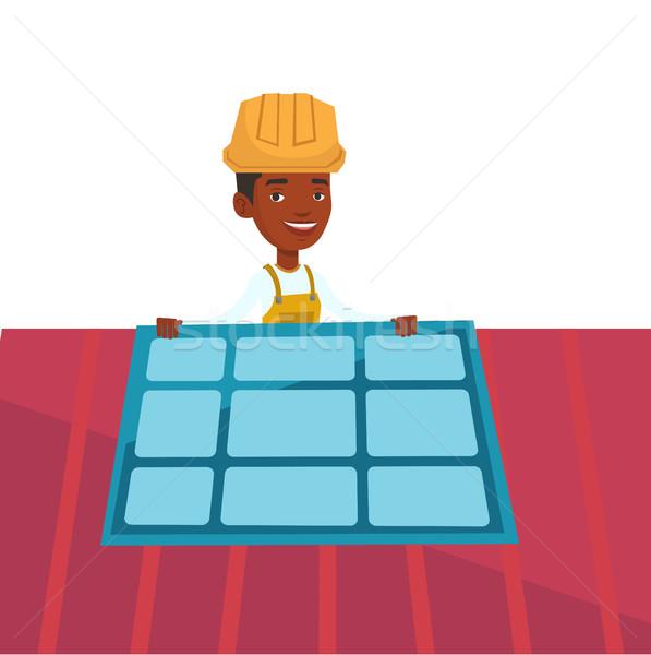 Technician installing solar panel. Stock photo © RAStudio