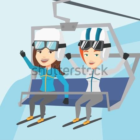 два счастливым лыжных курорта женщины сидят Сток-фото © RAStudio