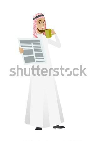 Muslim business woman reading newspaper. Stock photo © RAStudio