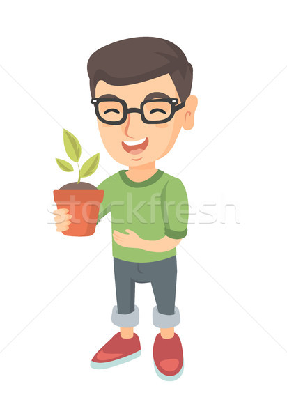 Caucasian smiling boy holding a potted plant. Stock photo © RAStudio