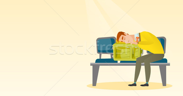 Exhausted man sleeping on suitcase at the airport. Stock photo © RAStudio