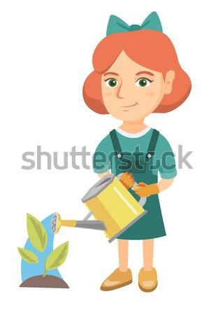 Girl pushing wheelbarrow with soil and plant. Stock photo © RAStudio