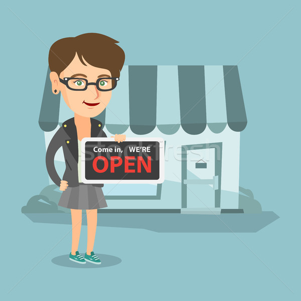 Młodych sklep właściciel otwarte Zdjęcia stock © RAStudio
