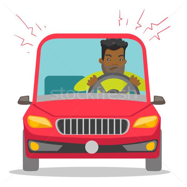 Angry black man in car stuck in traffic jam. Stock photo © RAStudio