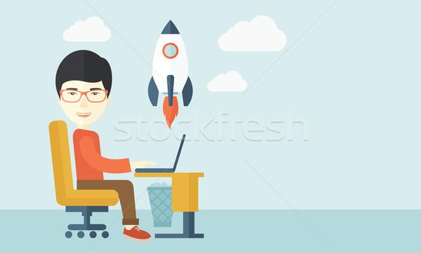 Asian man and his laptop. Stock photo © RAStudio
