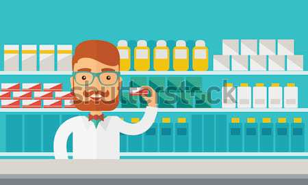Fiatal gyógyszertár vegyész férfi áll drogéria Stock fotó © RAStudio