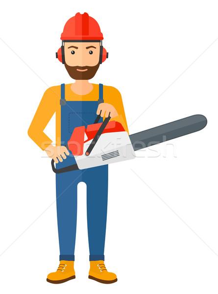 Cheerful lumberjack with chainsaw. Stock photo © RAStudio