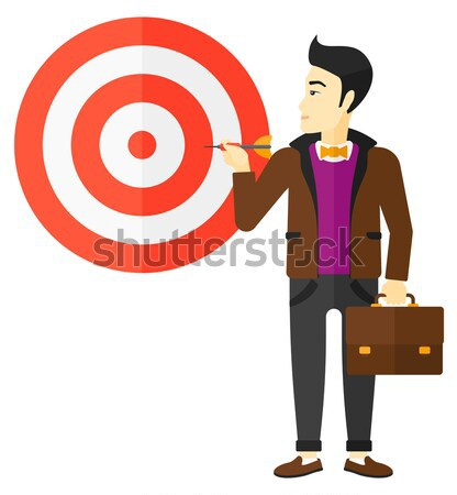 Businessman with target board. Stock photo © RAStudio