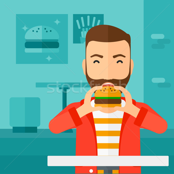 Stockfoto: Man · eten · hamburger · baard · cafe
