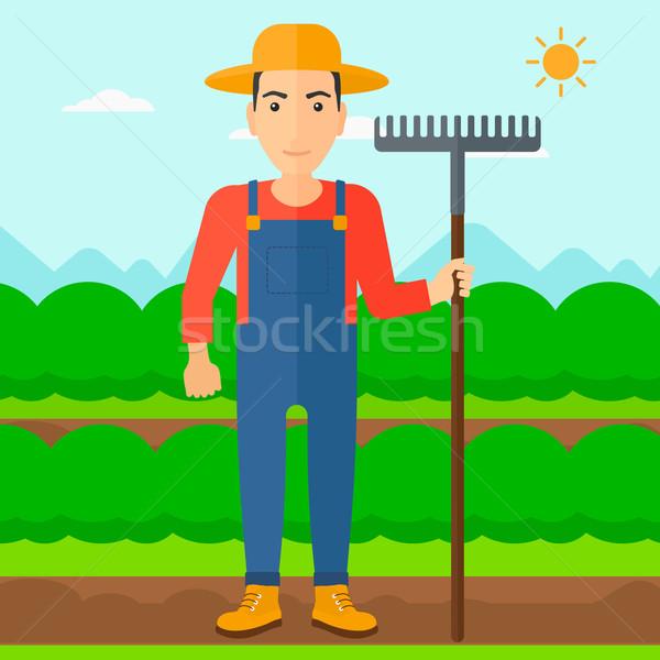 çiftçi tırmık adam ayakta alan Stok fotoğraf © RAStudio