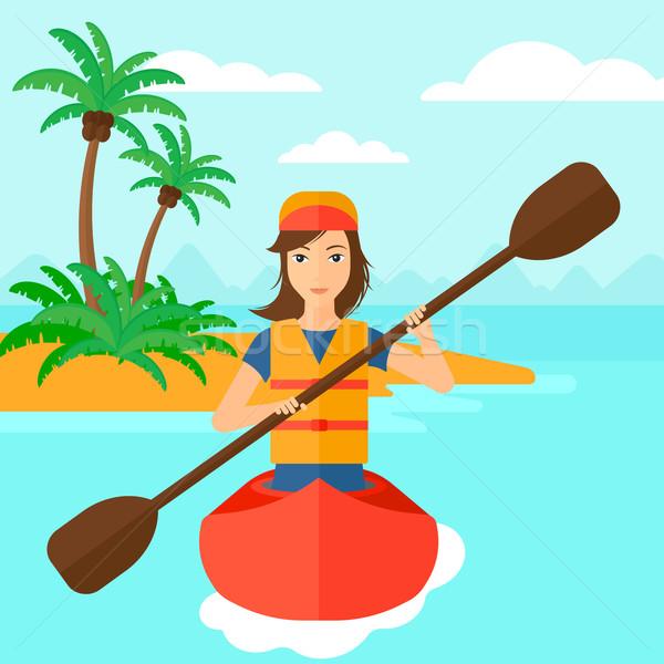 Woman riding in canoe. Stock photo © RAStudio