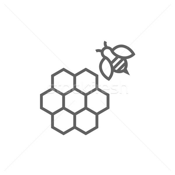 Honeycomb and bee line icon. Stock photo © RAStudio