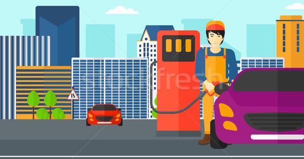 Adam doldurma yukarı yakıt araba Asya Stok fotoğraf © RAStudio