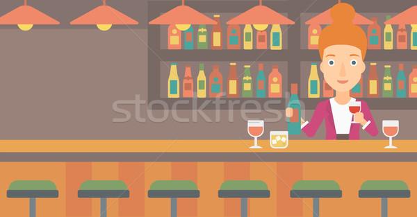 Csapos áll bár pult tart üveg Stock fotó © RAStudio