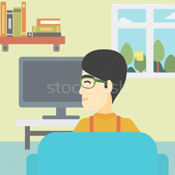 Adam izlerken tv Asya genç oturma Stok fotoğraf © RAStudio