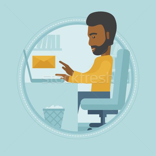 üzletember küldés email dolgozik laptop iroda Stock fotó © RAStudio