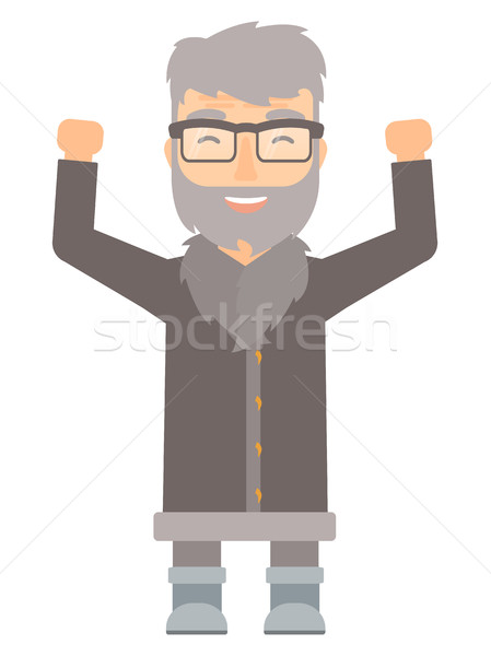 North man standing with raised arms up. Stock photo © RAStudio