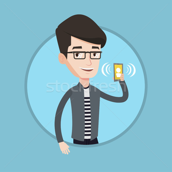 Man holding ringing mobile phone. Stock photo © RAStudio