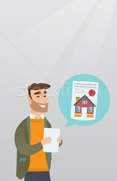 Człowiek czytania nieruchomości reklama młodych Zdjęcia stock © RAStudio