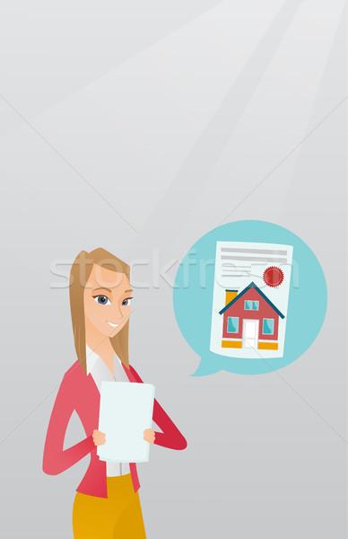 Woman reading real estate advertisement. Stock photo © RAStudio