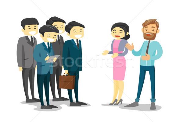 Multiethnic delegates networking during conference Stock photo © RAStudio