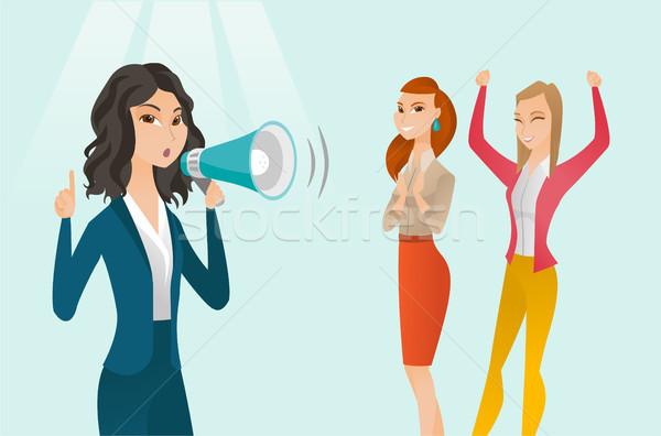 Caucasian white feminist shouting into a megaphone Stock photo © RAStudio