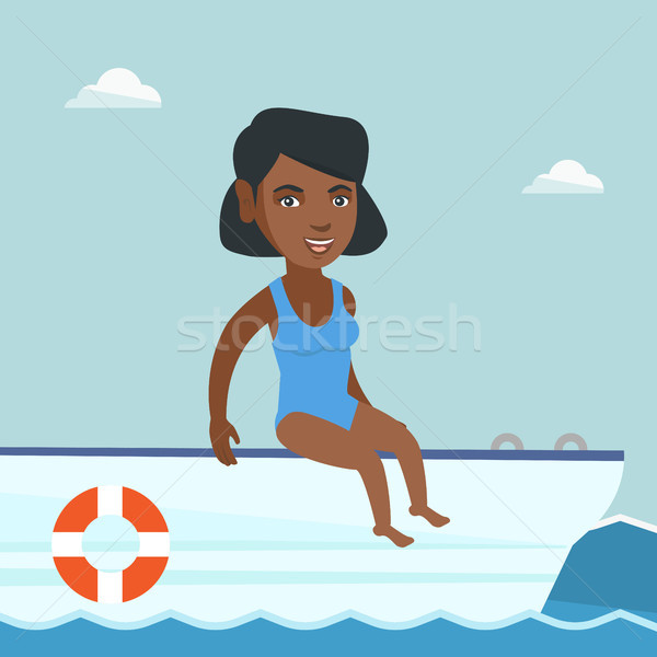 Young african-american woman tanning on a sailboat Stock photo © RAStudio
