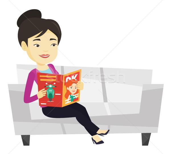 женщину чтение журнала диван молодые азиатских Сток-фото © RAStudio
