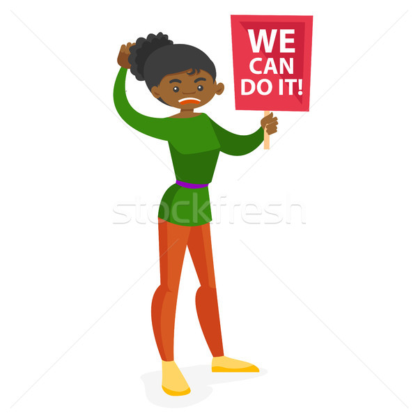 Young feminist holding placard at protest action. Stock photo © RAStudio