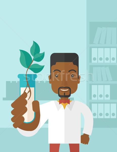 Black guy Chemist with tube and eco leaves. Stock photo © RAStudio