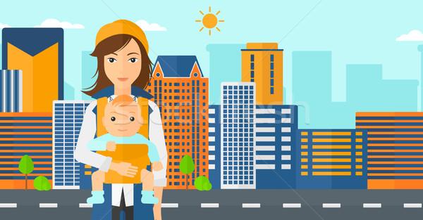Nő tart baba csúzli modern város Stock fotó © RAStudio