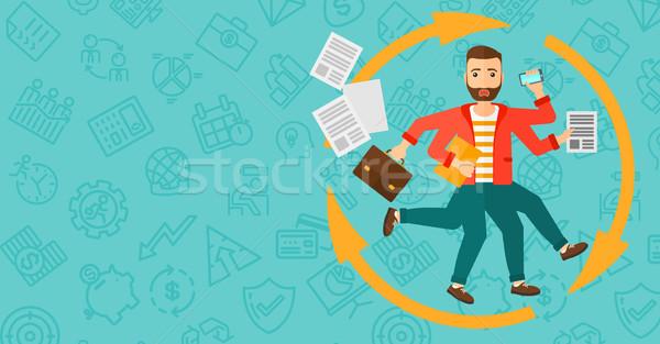 Man coping with multitasking. Stock photo © RAStudio