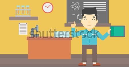 Man holding tablet computer. Stock photo © RAStudio