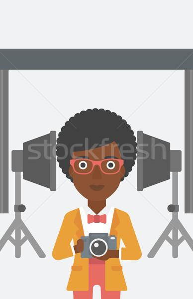 улыбаясь фотограф камеры женщину фото Сток-фото © RAStudio