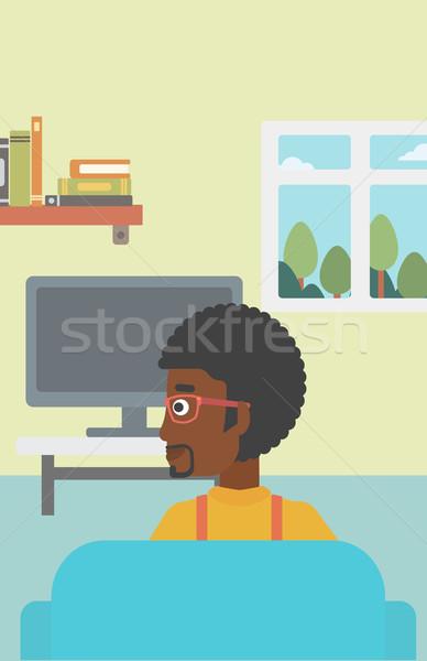 Adam izlerken tv oturma kanepe oturma odası Stok fotoğraf © RAStudio