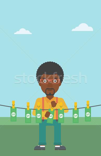 Man loundering money vector illustration. Stock photo © RAStudio