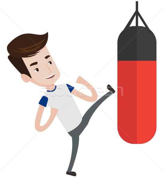 Man exercising with punching bag. Stock photo © RAStudio