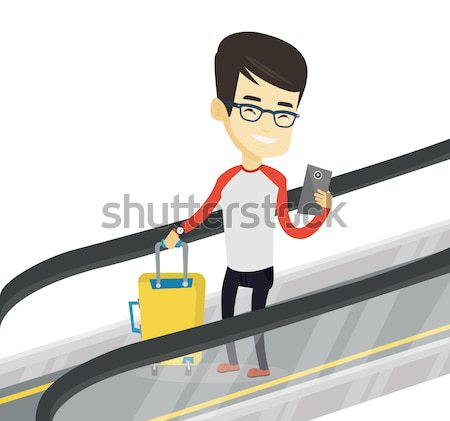 Man smartphone roltrap luchthaven asian permanente Stockfoto © RAStudio