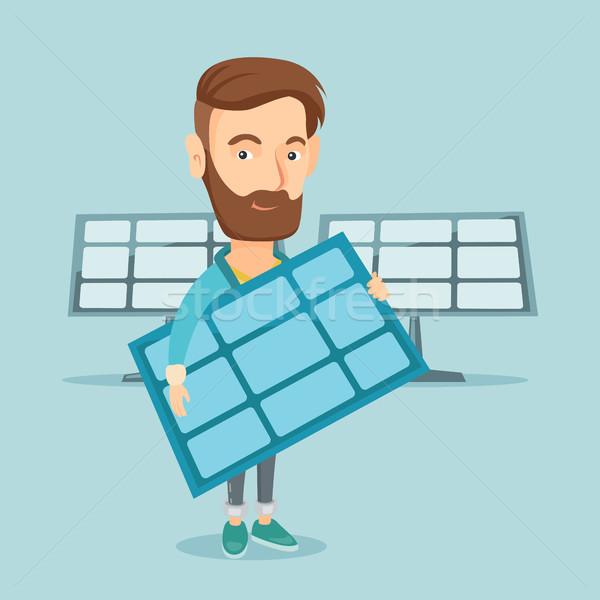 Man holding solar panel vector illustration. Stock photo © RAStudio