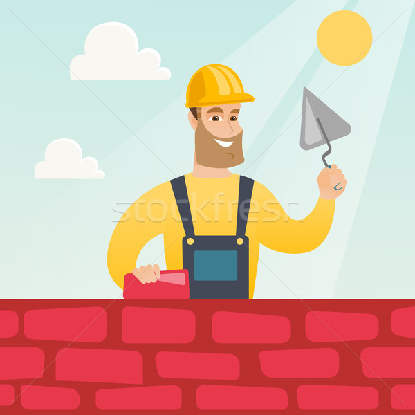 Bricklayer working with spatula and brick. Stock photo © RAStudio
