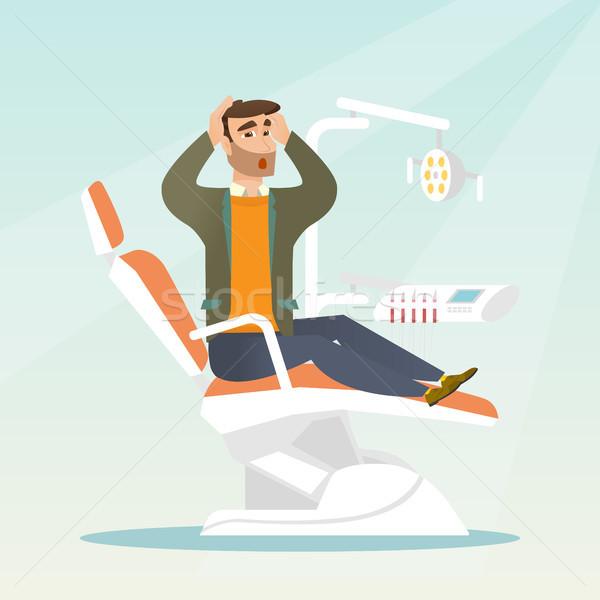 Félő férfi ül fogászati szék ijedt Stock fotó © RAStudio