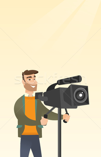 Cameraman with a movie camera on tripod. Stock photo © RAStudio