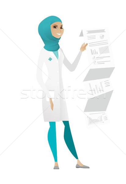 Doctor in medical gown giving presentation. Stock photo © RAStudio
