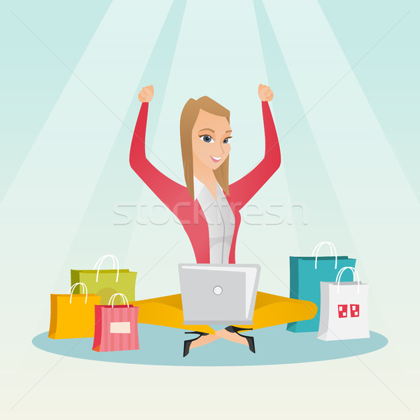 Caucasian woman using a laptop for online shopping Stock photo © RAStudio