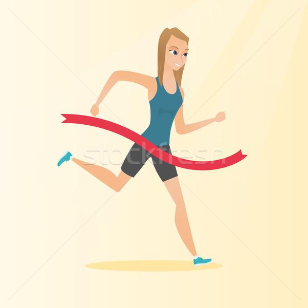 Young caucasian sportswoman crossing finish line. Stock photo © RAStudio