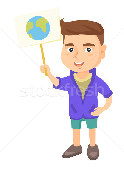 Caucasian boy holding a placard with planet. Stock photo © RAStudio
