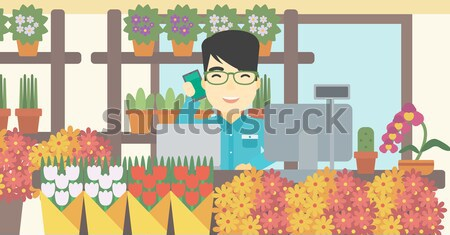 Florist at flower shop vector illustration. Stock photo © RAStudio